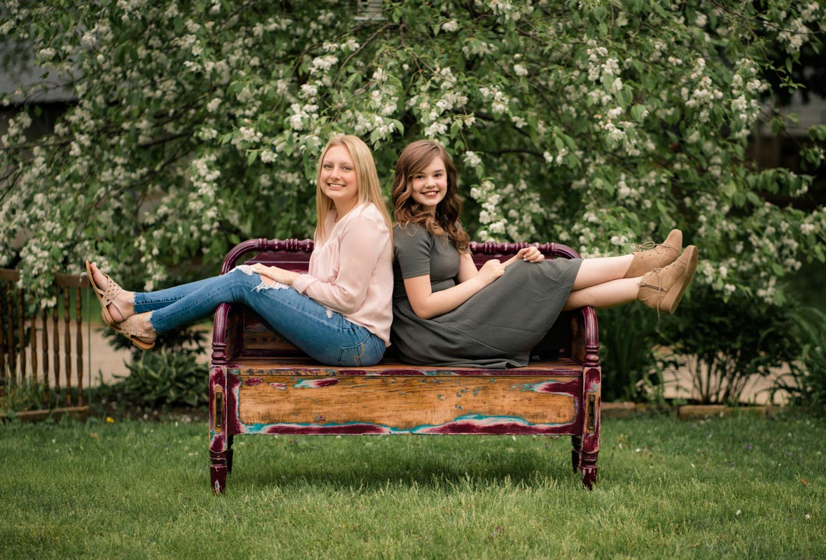 Family Photography in Baraboo Wisconsin two girls sitting on bench