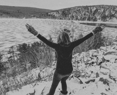 image of steph shanks photography standing on side of bluff